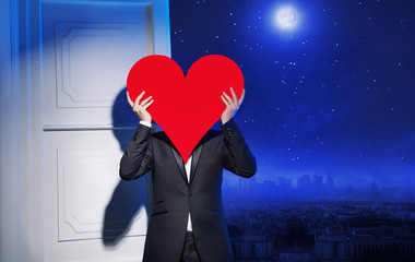 Young guy holding a heavy red heart