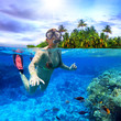 Young women at snorkeling in the tropical water - 77963237