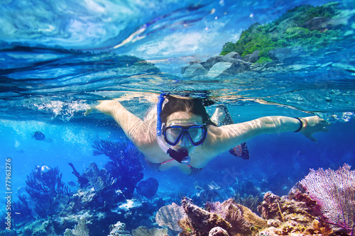 Young women at snorkeling in the tropical water - 77963276
