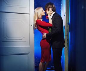 Handome boyfriend kissing his girlfriend