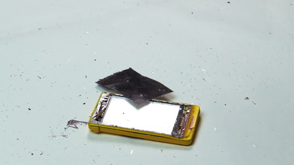 Destruction of a Cell Phone with a Hammer, close-up