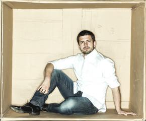 focused businessman sitting in a box