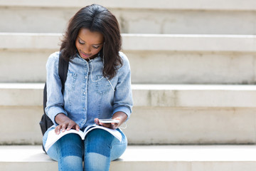african american college student reading a book