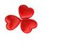 Three red fabric hearts.