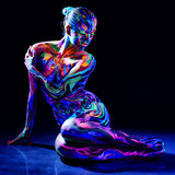 Charming nude girl with luminescent body art poster