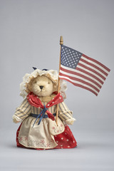 Bear Doll dressed in red,white and blue holding American flag