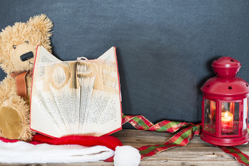 old bear, vintage old book and red lamp