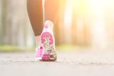Fototapeta Female Runner Shoes closeup before Running at Park.