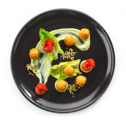 Plate of cheese balls and vegetables