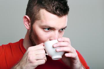 sporty guy drinking coffee