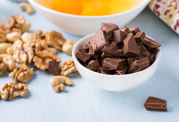 Chocolate chunks in a bowl. Food ingredients.