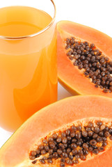 papaya fruit and glass of juice isolated on white