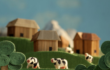 Countryside landscape with cows made of wool