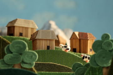 Countryside landscape animation with cows made of wool
