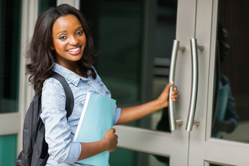 african female college student going to lecture hall