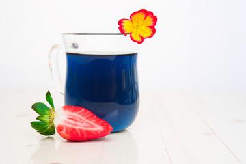 Blue Thai tea and strawberries