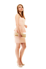 Elegance. Full length of girl in pink dress and with handbag