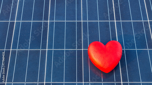 red heart on a solar panel texture - 77969478