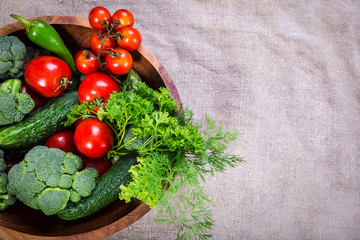 vegetables on wooden plate with copy space