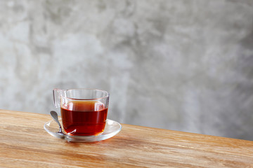 cup of tea on table in front of wall