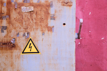 rusty electrical box on  pink background wall