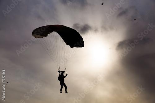 Fototapeta skydiver silhouette against sky