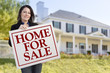 Woman Holding Home For Sale Sign in Front of House