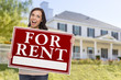 Ethnic Female Holding For Rent Sign In Front of House