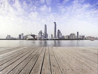 Empty board with skyline and cityscape background