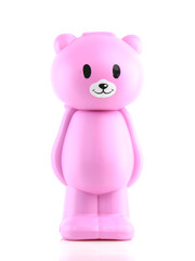 Close up of a plastic toy bear isolated on white background