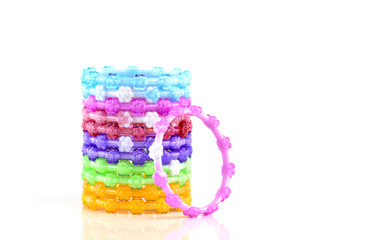 colorful plastic toy bangle on white background