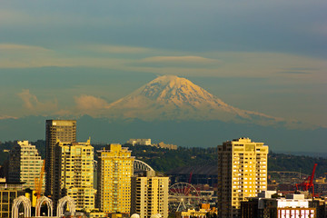 Mount Rainier and Seattle buildings at sunset hours