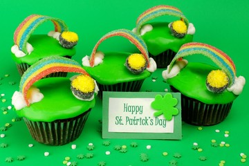St Patricks Day cupcakes with greeting card on green