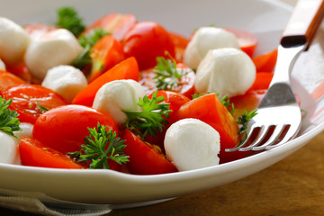 Italian salad with tomatoes and mozzarella (caprese)