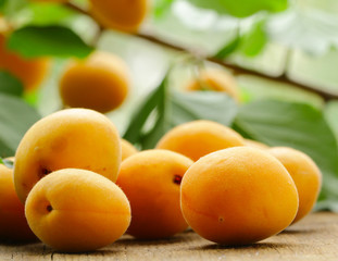 natural organic ripe apricots on a wooden table