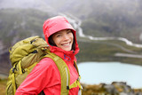 Happy young asian hiker woman hiking portrait