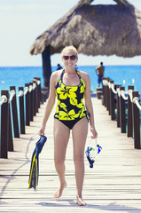 Woman going snorkeling while on a tropical vacation