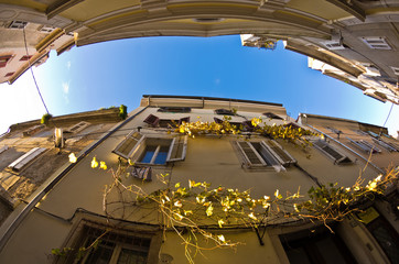 Old houses at backstreets of Piran, coastal town in Istria
