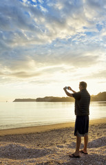 Taking a picture of a Peaceful Morning Sunrise