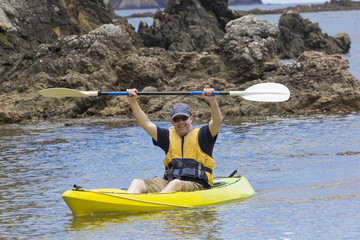 Man enjoying an ocean kayaking trip