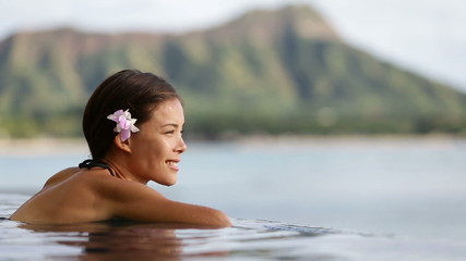 Vacation woman swimming at infinity pool on Hawaii