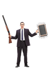 Businessman holding rifle and a bag full of money