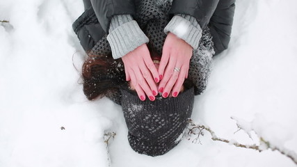 girl is closed from the falling snow