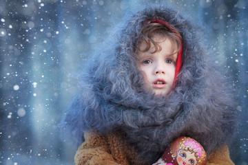 portrait of a little girl in a headscarf