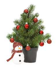 christmas tree in a pot isolated on white,red spheres. Snowman