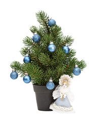 christmas tree in a pot isolated, blue spheres. Snow Maiden