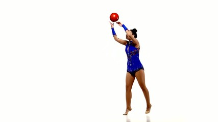 Active young girl gymnast with acrobatics ball