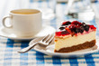 Cake on plate with fork and coffee cup - 77980880
