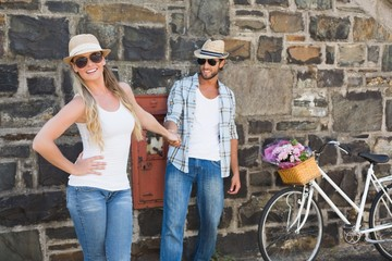 Attractive couple standing with bikes