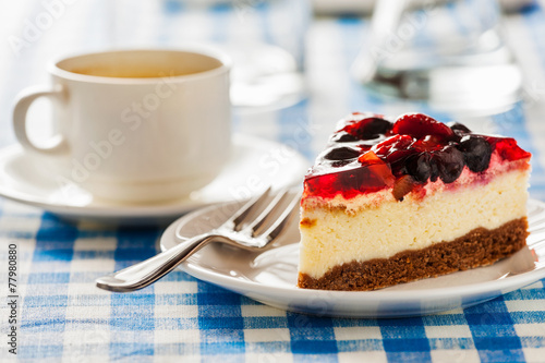 Tuinposter Koekjes Cake on plate with fork and coffee cup